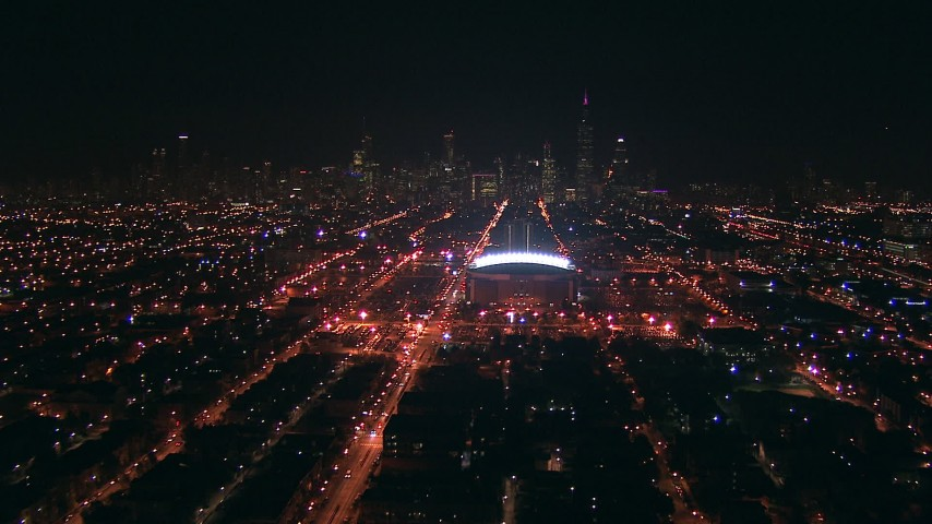 HD stock footage aerial video approach United Center arena and the Downtown Chicago, Illinois skyline at night from the West Side Aerial Stock Footage | ED0001_000006