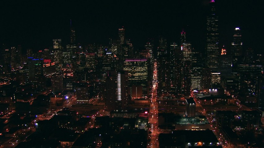 HD stock footage aerial video follow Monroe Street at night toward skyscrapers in Downtown Chicago, Illinois Aerial Stock Footage | ED0001_000009