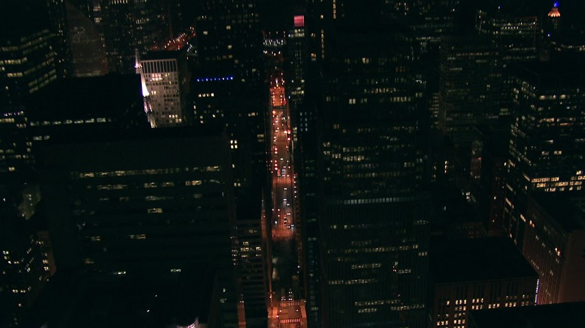 HD stock footage aerial video tilt to a bird's eye view of city street lined with skyscrapers at night in Downtown Chicago, Illinois Aerial Stock Footage | ED0001_000011