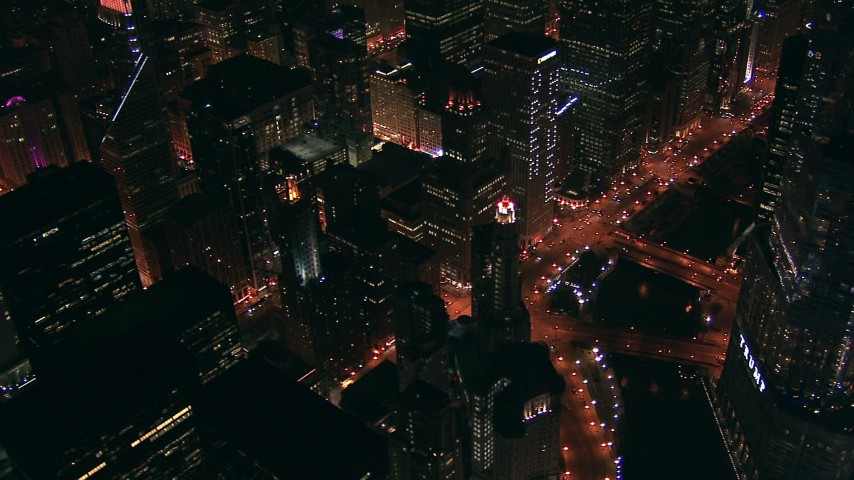 HD aerial video of skyscrapers, streets, and Trump Tower beside the river at night Downtown Chicago, Illinois Aerial Stock Footage | ED0001_000015