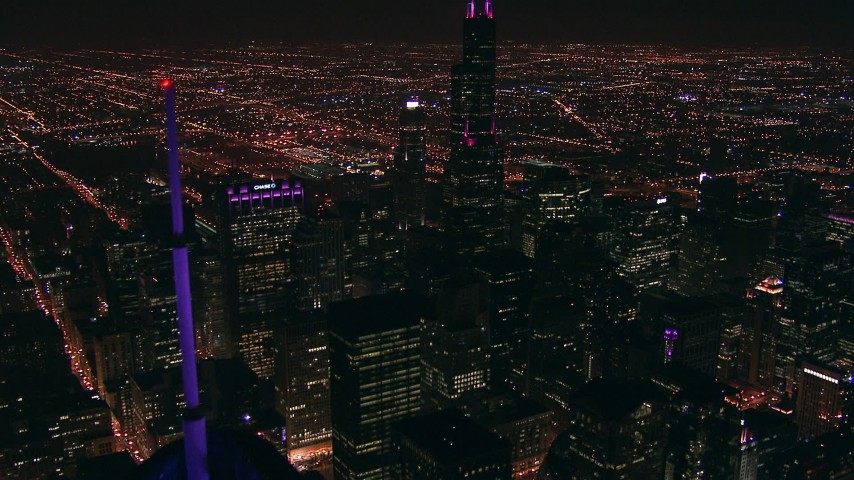 HD aerial video tilt from Trump Tower skyscraper to reveal Willis Tower at night in Downtown Chicago, Illinois Aerial Stock Footage | ED0001_000016