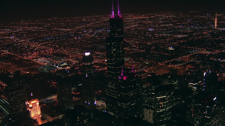HD stock footage aerial video approach iconic skyscraper, Willis Tower, at night, Downtown Chicago, Illinois Aerial Stock Footage | ED0001_000018