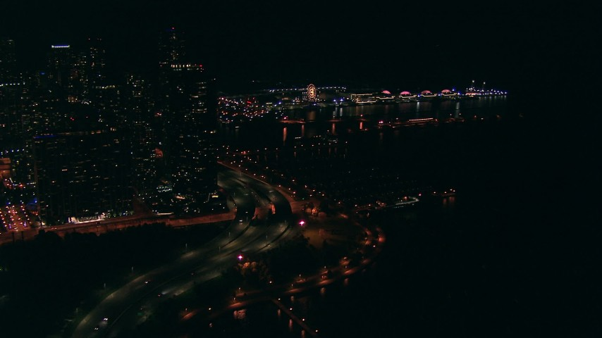 HD stock footage aerial video approach historic Navy Pier at night in Downtown Chicago, Illinois Aerial Stock Footage | ED0001_000022