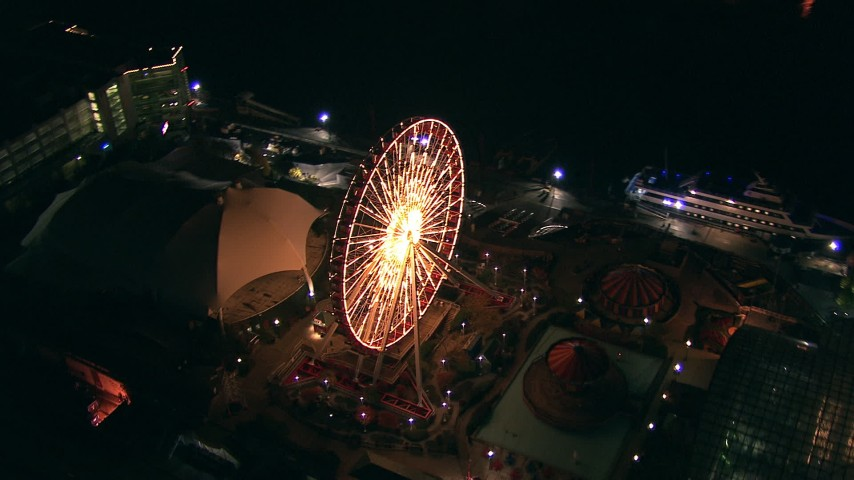 HD stock footage aerial video of a reverse view of the Ferris wheel on Navy Pier at night, Downtown Chicago, Illinois Aerial Stock Footage | ED0001_000025