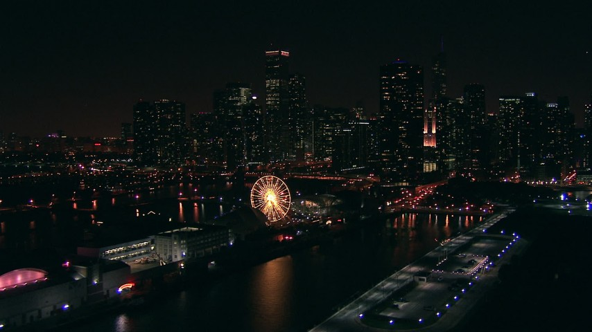 HD stock footage aerial video of a reverse view of Navy Pier and Ferris wheel, and the skyline of Downtown Chicago at night, Illinois Aerial Stock Footage | ED0001_000026
