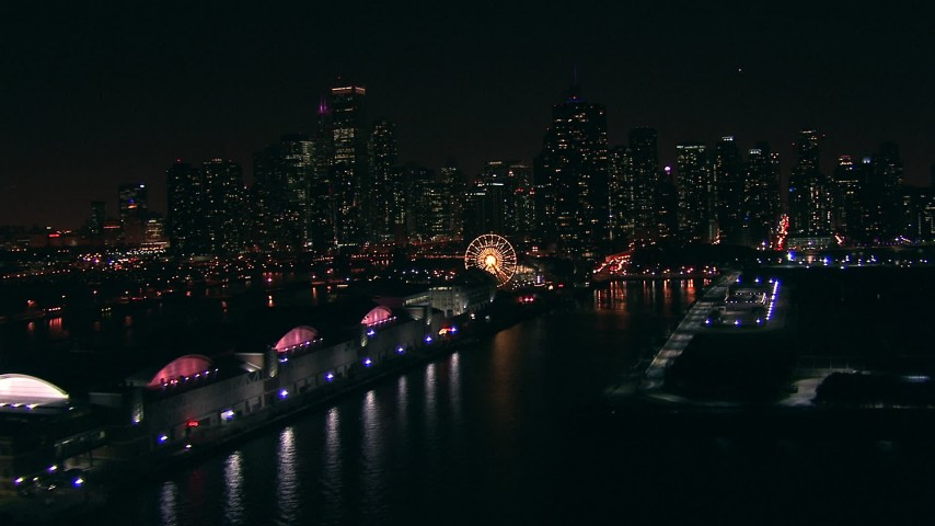 HD stock footage aerial video flyby the end of Navy Pier at night, with a view of the city skyline, Downtown Chicago, Illinois Aerial Stock Footage | ED0001_000027