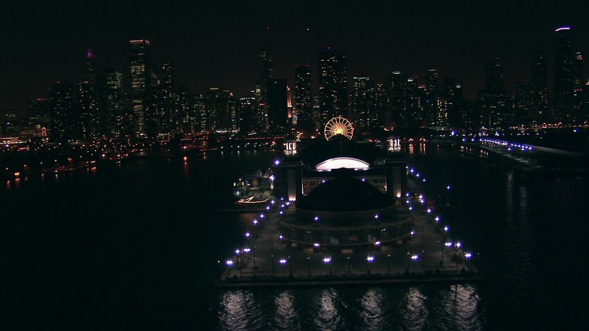 HD stock footage aerial video flyby the end of Navy Pier at night with the city skyline in the background, Downtown Chicago, Illinois Aerial Stock Footage | ED0001_000028