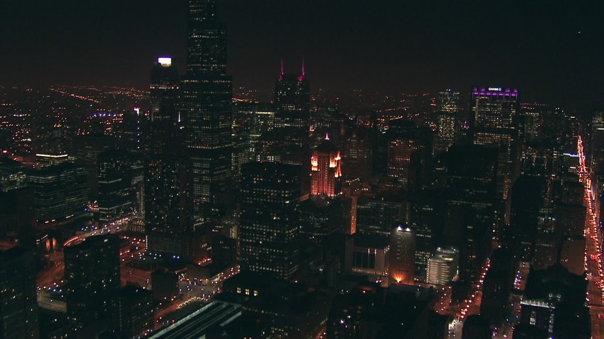 HD stock footage aerial video tilt from city streets to reveal Willis Tower skyscraper at night, Downtown Chicago, Illinois Aerial Stock Footage | ED0001_000035