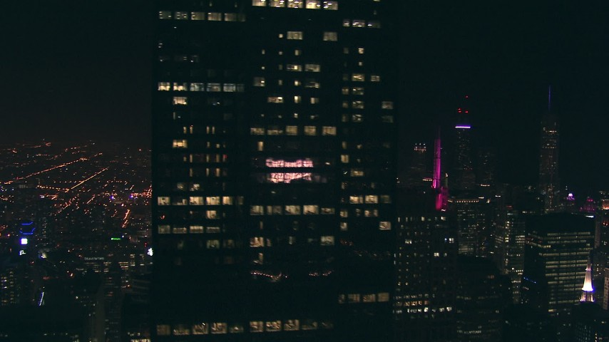 HD stock footage aerial video tilt and pass by Willis Tower skyscraper at night in Downtown Chicago, Illinois Aerial Stock Footage | ED0001_000037