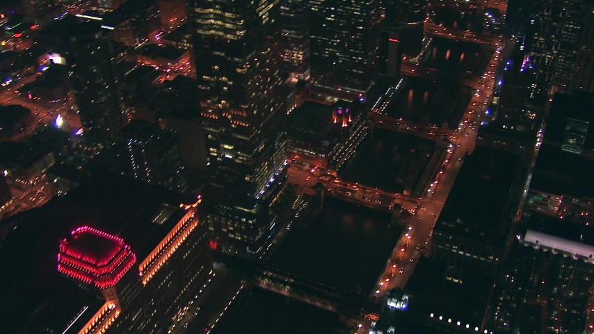 HD stock footage aerial video pan across Merchandise Mart and bridges over the Chicago River at night, Downtown Chicago, Illinois Aerial Stock Footage | ED0001_000038