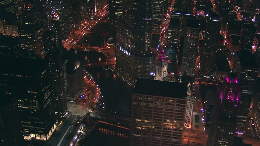 HD stock footage aerial video zoom to a wider view of the Chicago River and Trump Tower skyscraper at night, Downtown Chicago, Illinois Aerial Stock Footage | ED0001_000040