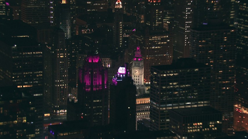 HD stock footage aerial video of Tribune Tower, Wrigley Building, and skyscrapers at night, Downtown Chicago, Illinois Aerial Stock Footage | ED0001_000041