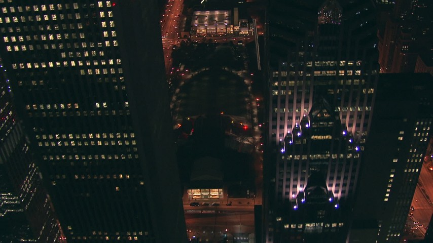 HD stock footage aerial video fly between skyscrapers, approach Jay Pritzker Pavilion and AT&T Park at night, Downtown Chicago, Illinois Aerial Stock Footage | ED0001_000045