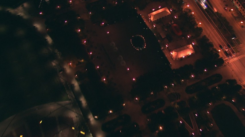 HD stock footage aerial video of a bird's eye view of the Cloud Gate Sculpture in AT&T Park at night in Downtown Chicago, Illinois Aerial Stock Footage | ED0001_000046