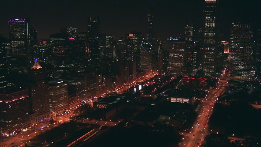 HD stock footage aerial video of skyscrapers bordering AT&T Park at night in Downtown Chicago, Illinois Aerial Stock Footage | ED0001_000047