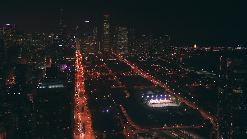 HD stock footage aerial video of Grant Park and Downtown Chicago skyscrapers at night, Illinois Aerial Stock Footage | ED0001_000048