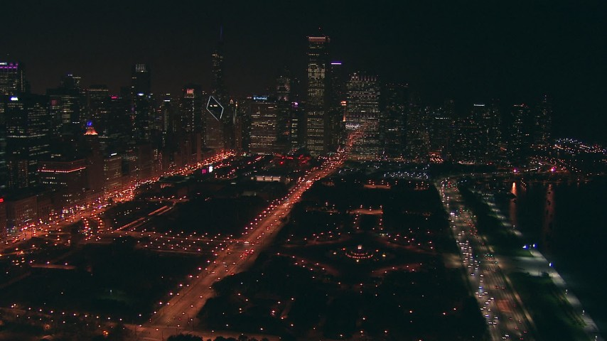 HD stock footage aerial video approach and flyby fountain at Grant Park, surrounded by skyscrapers, at night, Downtown Chicago, Illinois Aerial Stock Footage | ED0001_000049