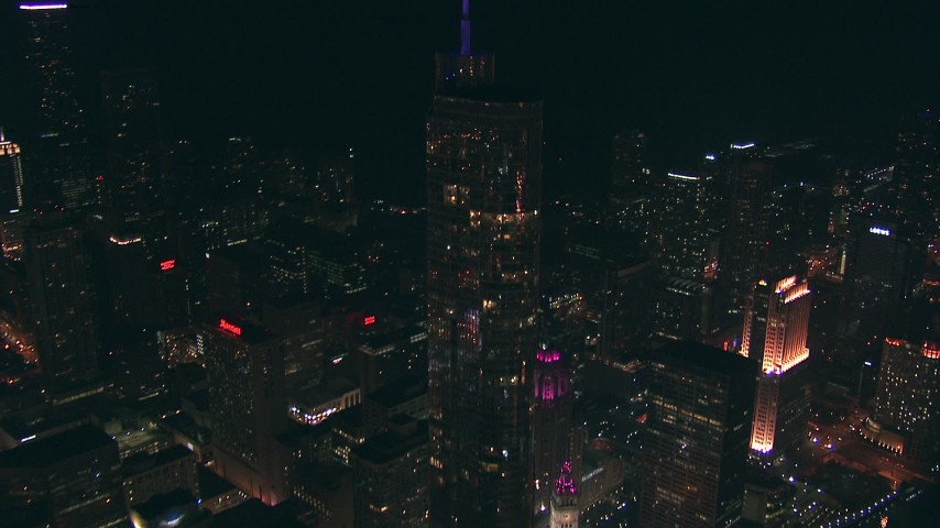 HD stock footage aerial video fly over Downtown Chicago, Illinois at night to approach Trump Tower skyscraper Aerial Stock Footage | ED0001_000053