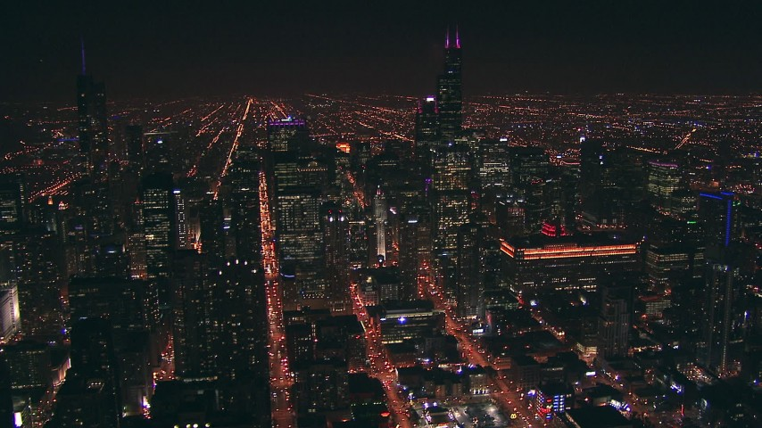 HD stock footage aerial video of Downtown Chicago, Illinois skyscrapers and city streets at night Aerial Stock Footage | ED0001_000055