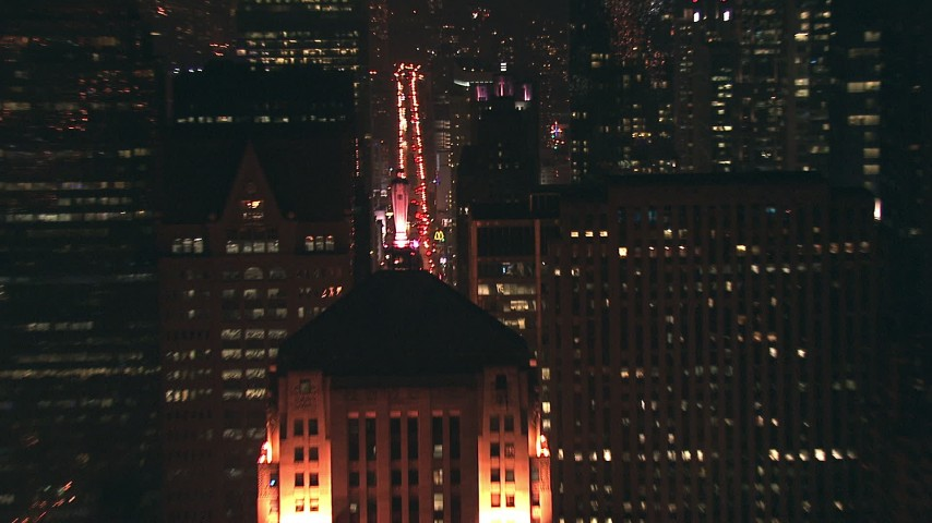 HD stock footage aerial video zoom to a closer view of the Chicago Board of Trade skyscraper rooftop at night, Downtown Chicago, Illinois Aerial Stock Footage | ED0001_000060