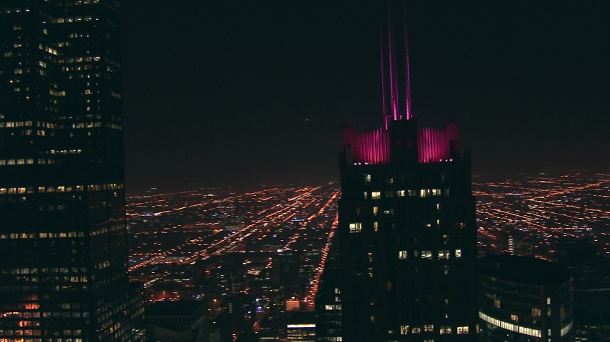 HD stock footage aerial video of the Franklin Center rooftop at night, reveal Willis Tower skyscraper, Downtown Chicago, Illinois Aerial Stock Footage | ED0001_000062