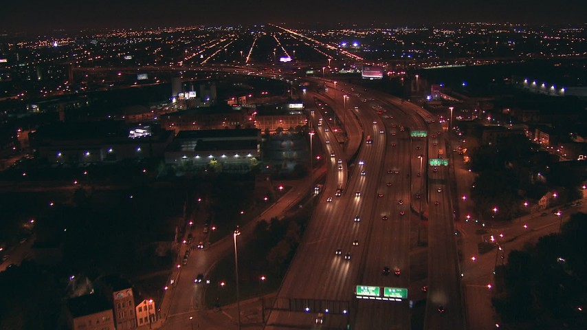 HD stock footage aerial video follow I-94 freeway through Downtown Chicago,  Illinois at night