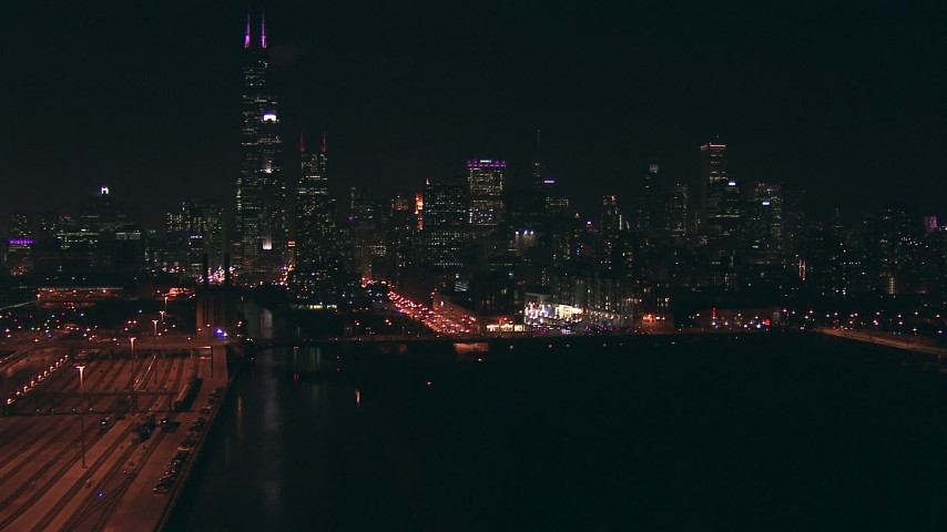 HD aerial video follow the Chicago River to approach Willis Tower skyscraper and Downtown Chicago, Illinois at night Aerial Stock Footage | ED0001_000068