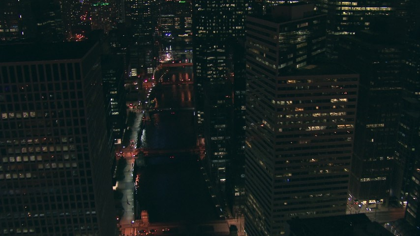 HD stock footage aerial video follow the Chicago River north over bridges and past skyscrapers at night Downtown Chicago, Illinois Aerial Stock Footage | ED0001_000071