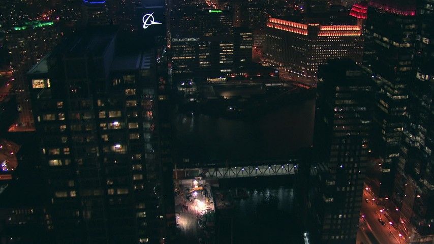 HD stock footage aerial video follow the Chicago River to reveal Merchandise Mart building at night, Downtown Chicago, Illinois Aerial Stock Footage | ED0001_000072