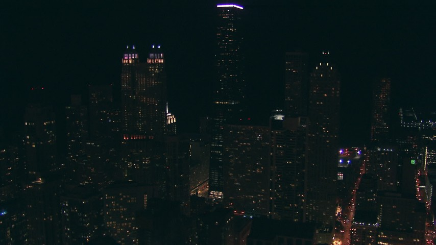 HD stock footage aerial video of 900 North Michigan and John Hancock Center skyscrapers at night, Downtown Chicago, Illinois Aerial Stock Footage | ED0001_000075