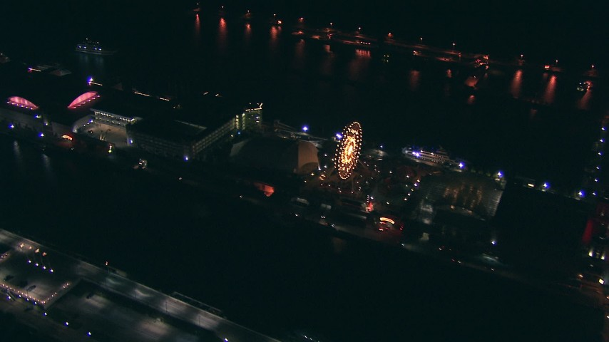 HD stock footage aerial video pan across the Ferris wheel and Navy Pier at night in Downtown Chicago, Illinois Aerial Stock Footage | ED0001_000077