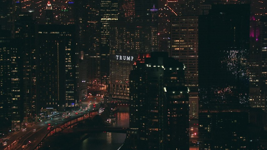 HD stock footage aerial video of base of Trump Tower skyscraper beside the Chicago River at night in Downtown Chicago, Illinois Aerial Stock Footage | ED0001_000078