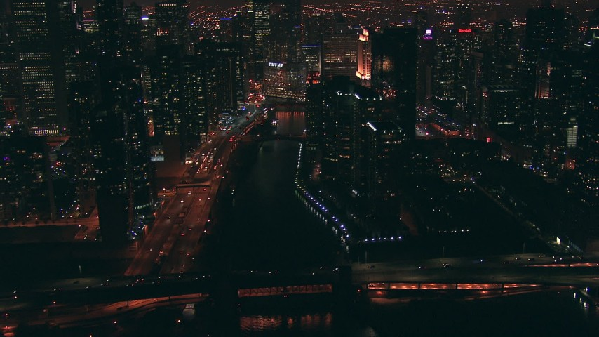 HD stock footage aerial video follow the Chicago River toward Trump Tower skyscraper at night in Downtown Chicago, Illinois Aerial Stock Footage | ED0001_000079
