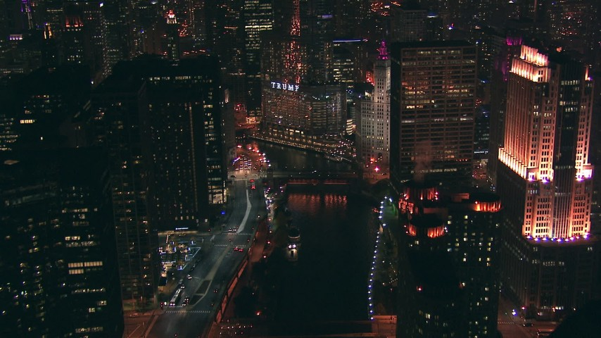 HD stock footage aerial video fly over the Chicago River bridges toward Trump Tower skyscraper sign at night, Downtown Chicago, Illinois Aerial Stock Footage | ED0001_000080
