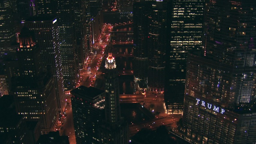 HD stock footage aerial video follow Chicago River past Trump Tower skyscraper at night, Downtown Chicago, Illinois Aerial Stock Footage | ED0001_000081