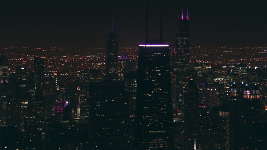 HD stock footage aerial video of John Hancock Center skyscraper, with Willis Tower in the distance at night, Downtown Chicago, Illinois Aerial Stock Footage ED0001_000086