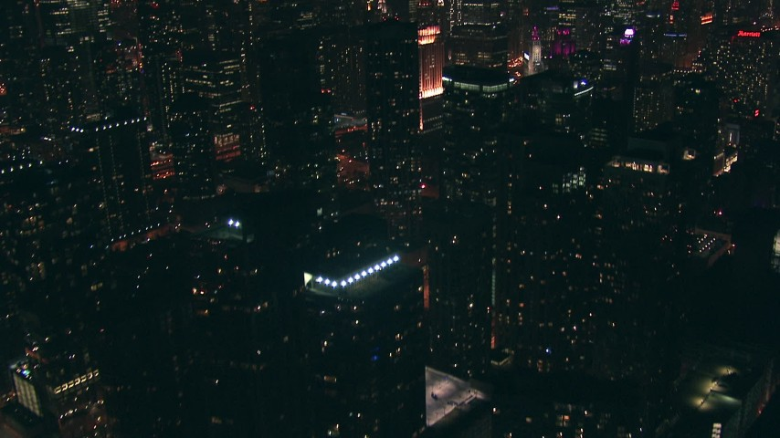 HD stock footage aerial video tilt from Lake Michigan to reveal and approach skyscrapers, Downtown Chicago, Illinois at nighttime Aerial Stock Footage | ED01_088