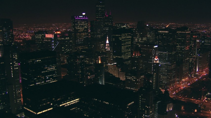 HD aerial video fly over city high-rises and skyscrapers at night in Downtown Chicago, Illinois Aerial Stock Footage   ED01_090