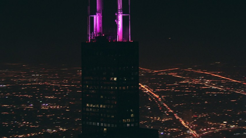 HD stock footage aerial video orbit Willis Tower skyscraper and zoom to wider view at night, Downtown Chicago, Illinois Aerial Stock Footage | ED01_094