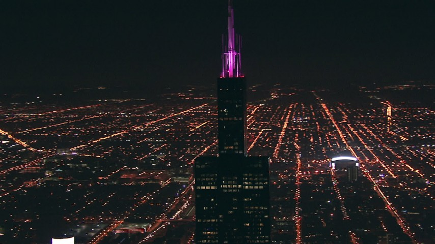 HD stock footage aerial video of an orbit of the iconic Willis Tower skyscraper at night in Downtown Chicago, Illinois Aerial Stock Footage | ED01_095