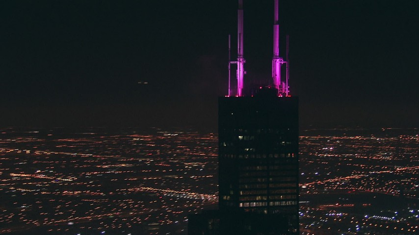 HD stock footage aerial video orbit around the top of Willis Tower skyscraper at nighttime in Downtown Chicago, Illinois Aerial Stock Footage | ED01_096
