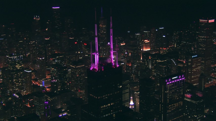 HD stock footage aerial video orbit the spires on top of Willis Tower skyscraper at night, Downtown Chicago, Illinois Aerial Stock Footage | ED01_099