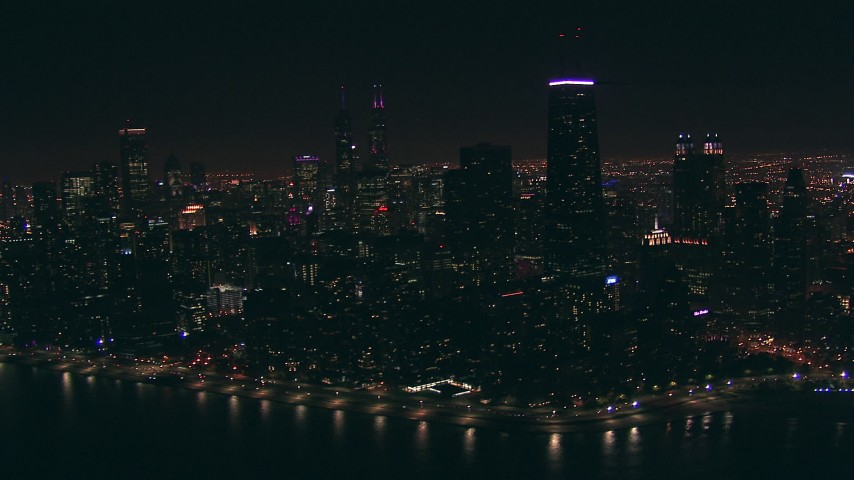 HD aerial video of a wide view of Downtown Chicago, Illinois skyscrapers at nighttime Aerial Stock Footage | ED01_102