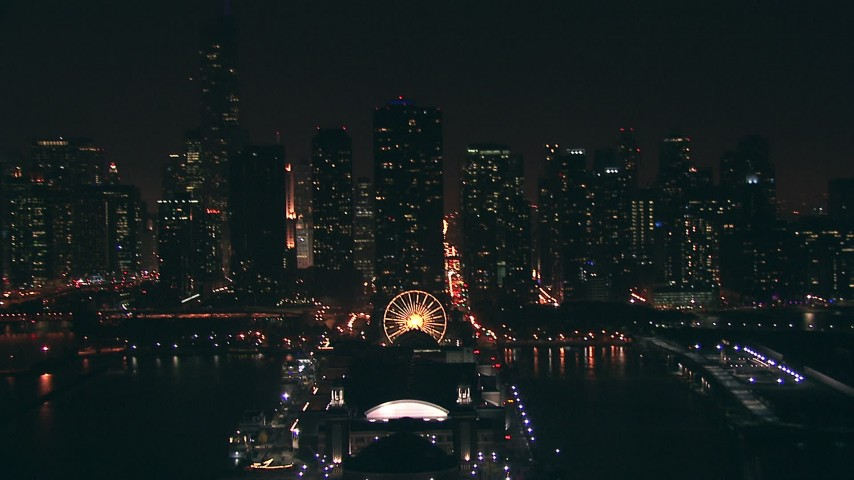 HD stock footage aerial video of Downtown Chicago skyscrapers, tilt to Navy Pier at night, Illinois Aerial Stock Footage | ED01_105