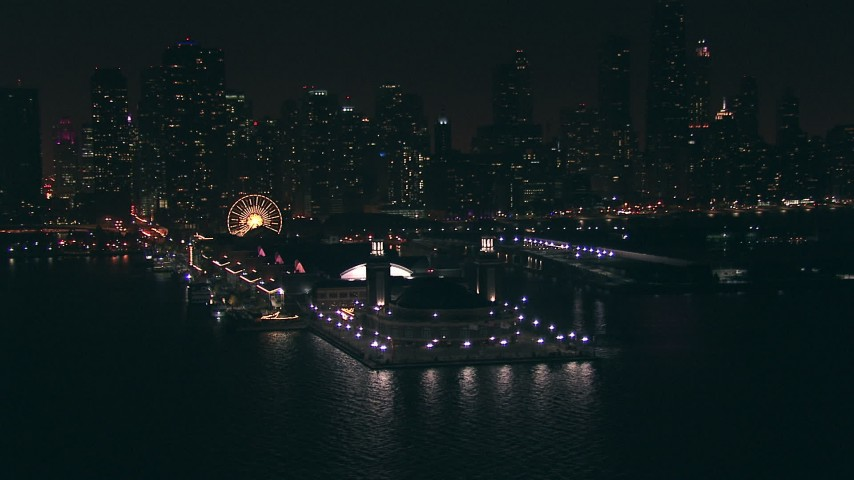 HD stock footage aerial video of the end of Navy Pier and Downtown Chicago skyscrapers at night, Illinois Aerial Stock Footage | ED01_106
