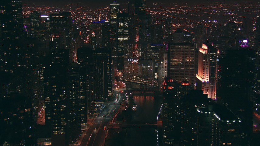 HD stock footage aerial video follow the Chicago River toward Trump Tower skyscraper at night, Downtown Chicago, Illinois Aerial Stock Footage ED01_109