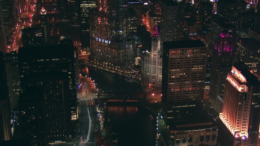 HD aerial video of the Trump Tower skyscraper and Chicago River bridges at night, Downtown Chicago, Illinois Aerial Stock Footage | ED01_110