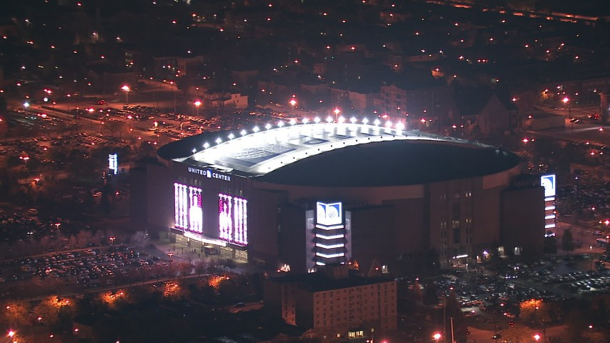 HD stock footage aerial video zoom in on United Center arena at night, West Side Chicago, Illinois Aerial Stock Footage | ED01_114