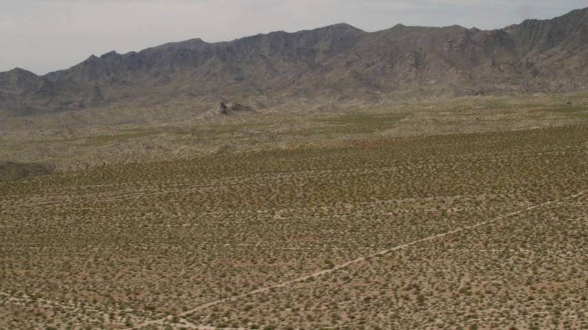 4K stock footage aerial video of Dead Mountains Wilderness Area seen from flat Mojave Desert plain in Laughlin, Nevada Aerial Stock Footage | FG0001_000024