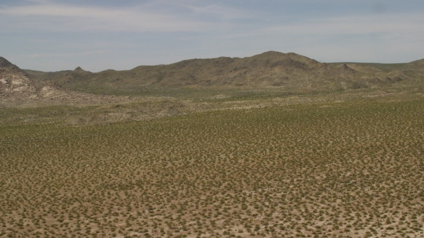 4K stock footage aerial video fly over Mojave Desert to approach Dead Mountains Wilderness Area in California Aerial Stock Footage | FG0001_000026
